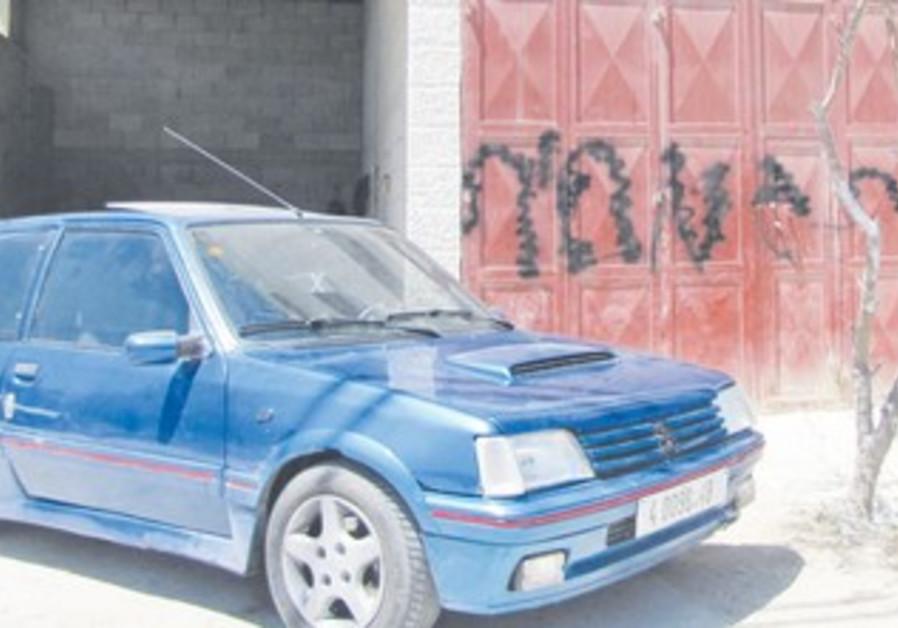 Car damaged in price tag attack [file]
