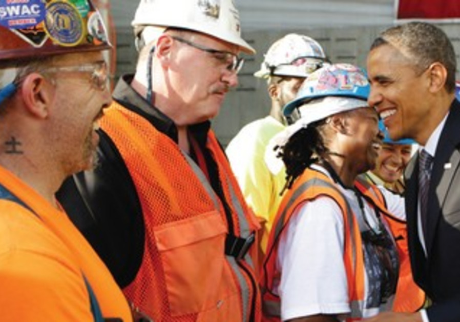US PRESIDENT Barack Obama greets workers in NY