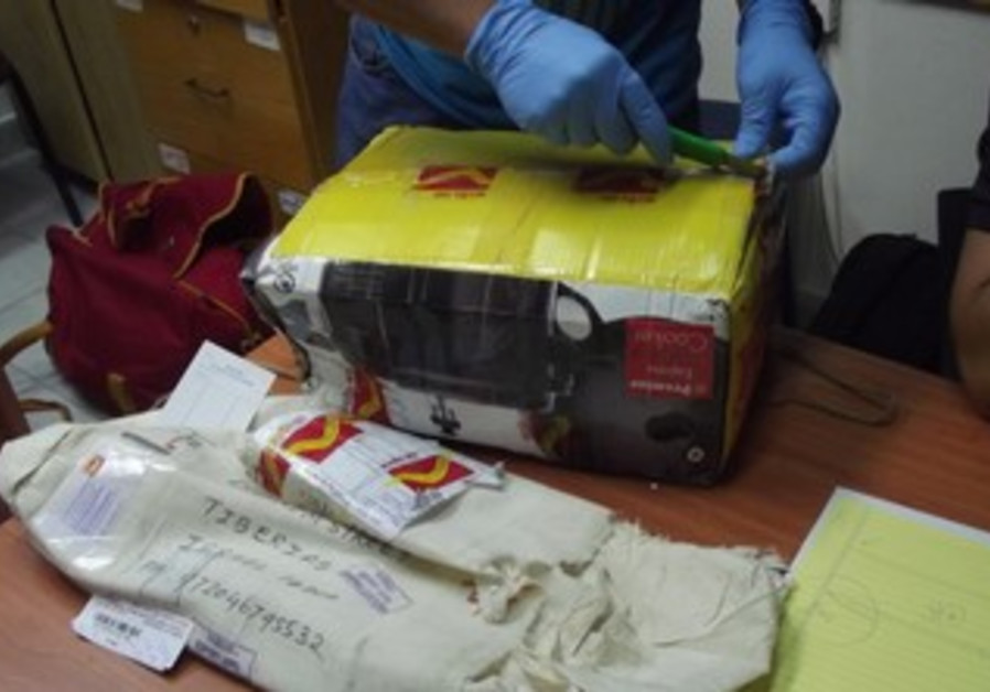 Police inspect drugs packages in Tiberias
