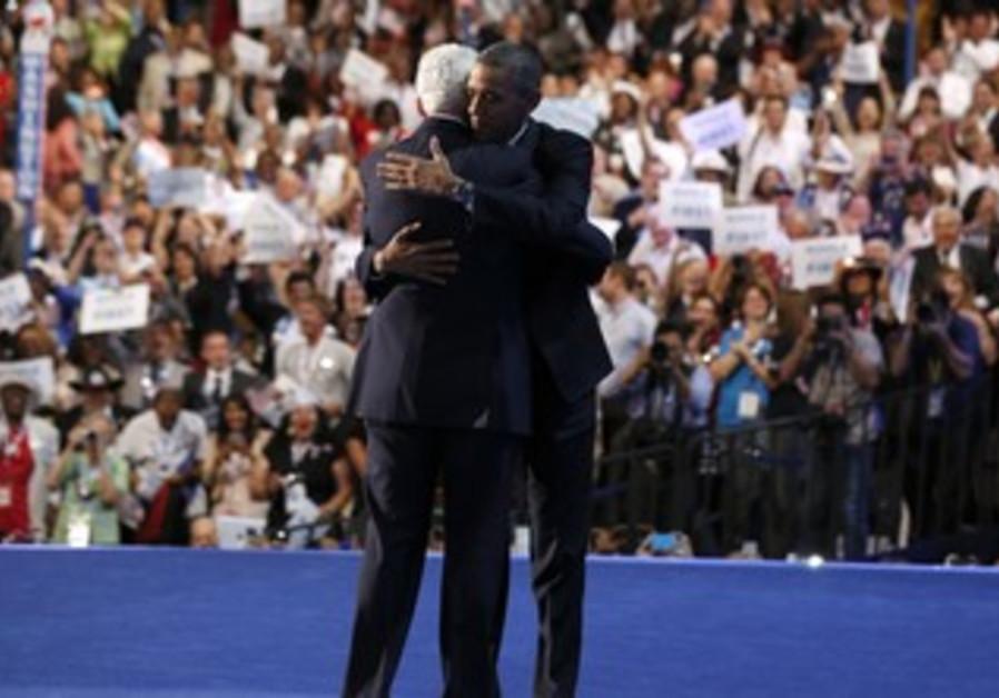 Obama embraces former President Bill Clinton