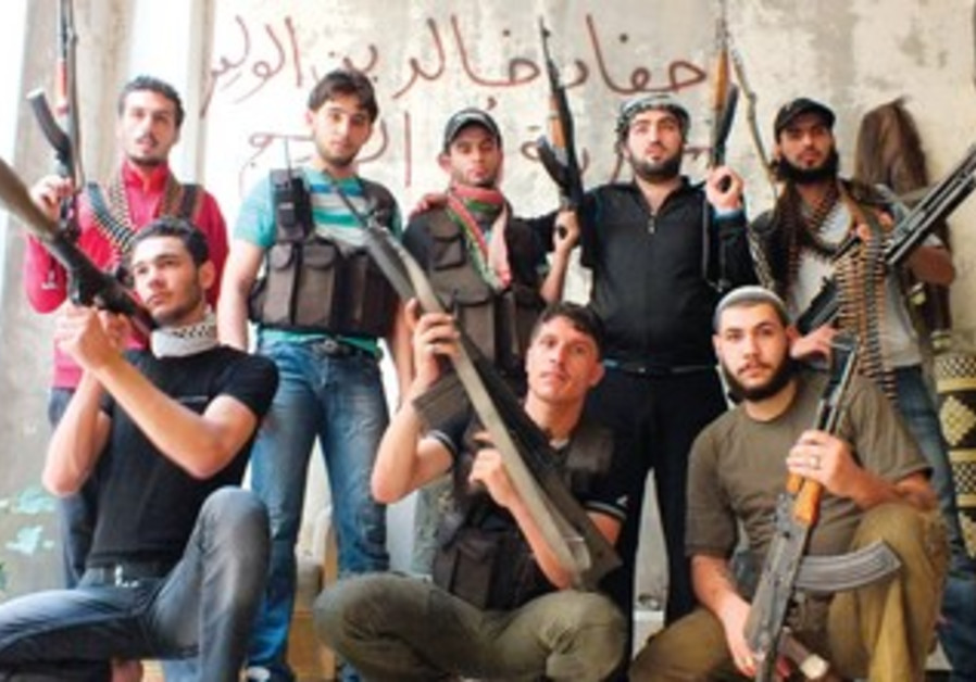 Rebel fighters pose with their weapons