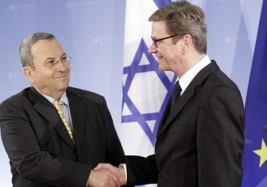 Barak shakes hands with Westerwelle