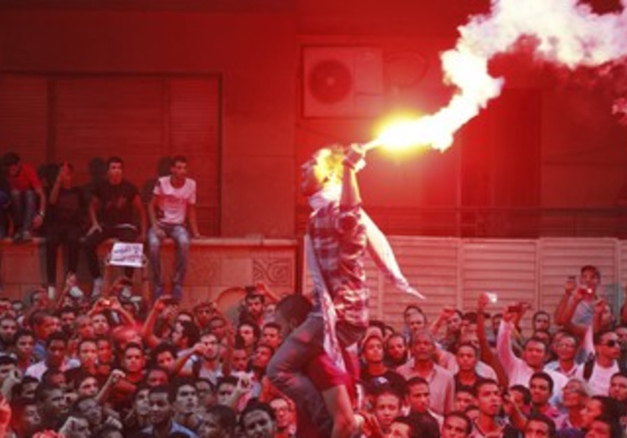 Protesters in front of the US embassy in Cairo