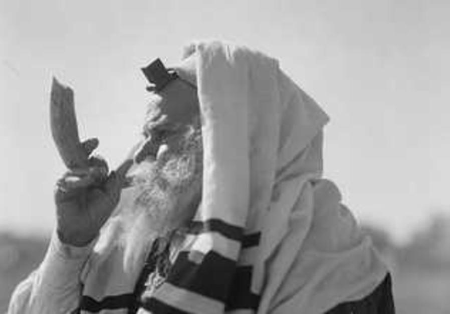 Rabbi blowing shofar