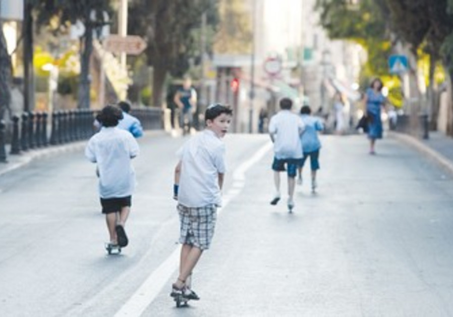 Kids ride scooters on Yom Kippur
