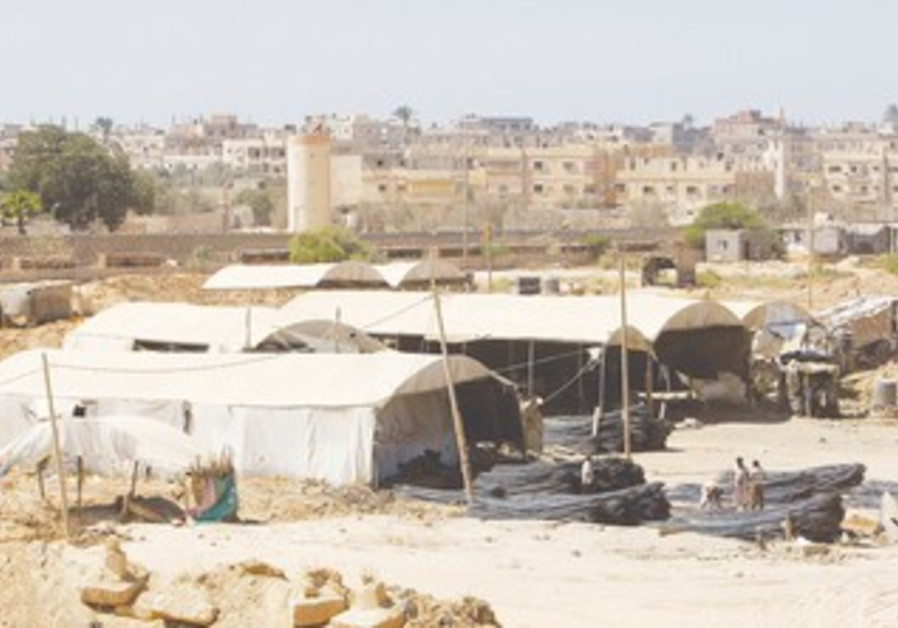 Gazans collect metal smuggled through tunnels