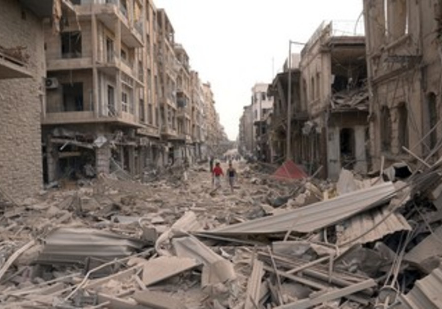 Residents walk through rubble after Aleppo blasts