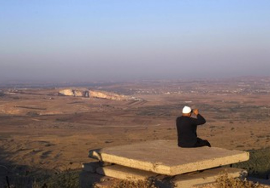 Druse man looks out at Syria from the Golan