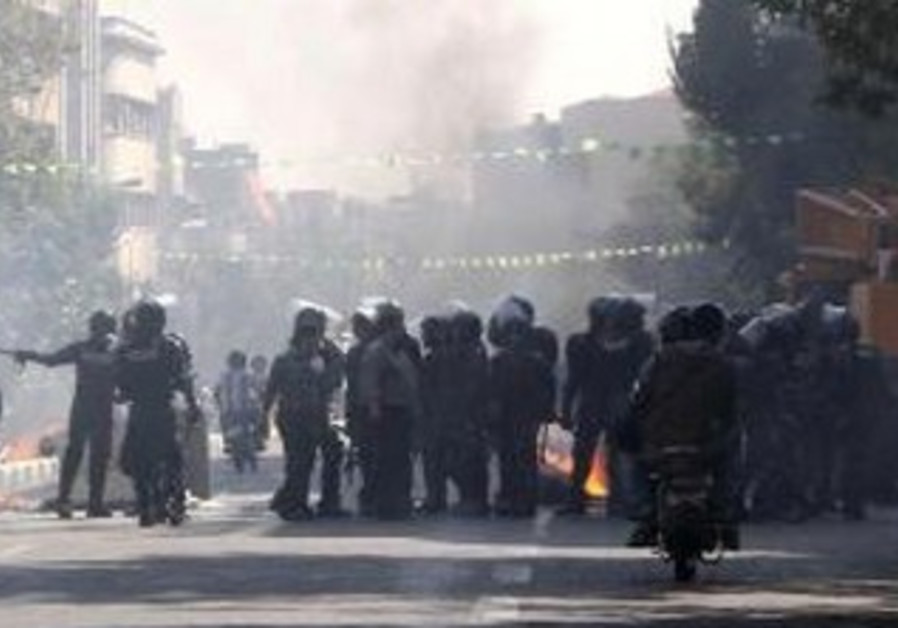 Iranian police clash with protesters in Tehran