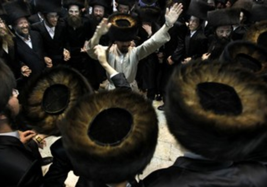 Haredi men dance on Simhat Torah