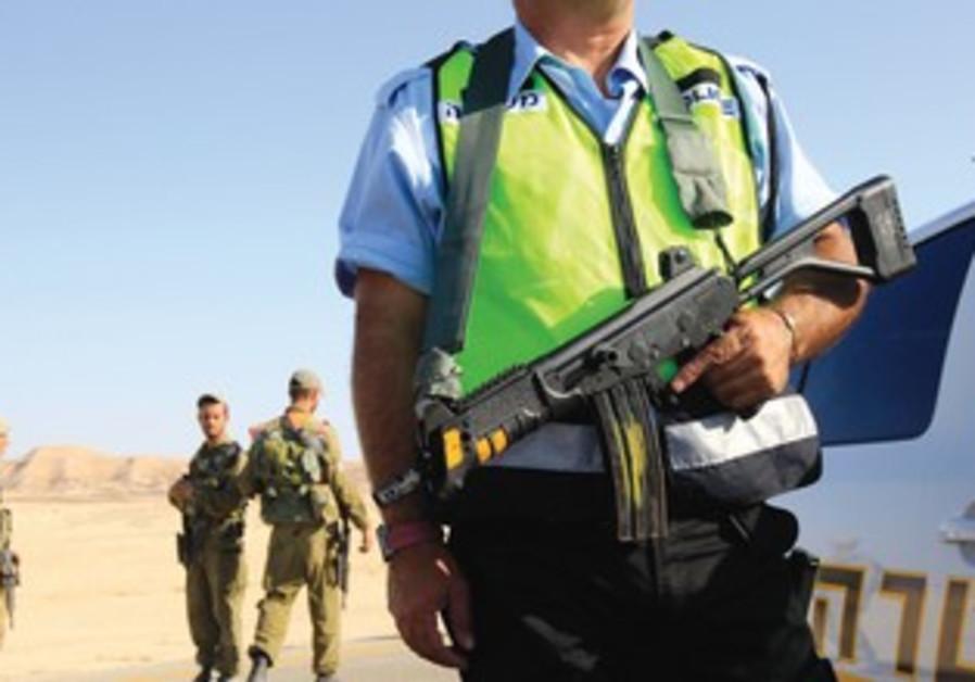 Policeman patrols near spot where bus was ambushed