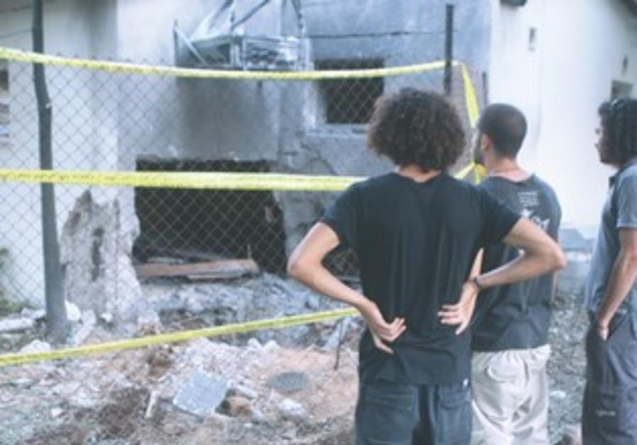 Eshkol region kibbutz home damaged by rocket