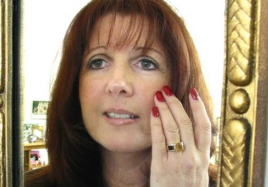 Woman applies face cream