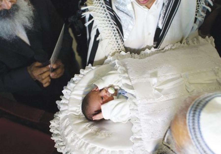 Baby undergoes circumcision