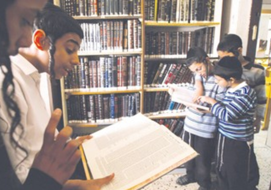 BOYS STUDY Talmud at their school's synagogue