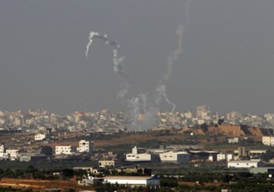 Trails of smoke from Gazan rockets fired at Israel