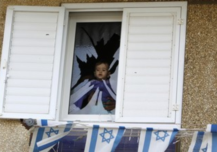 Baby in window of Netivot home damaged by Grad