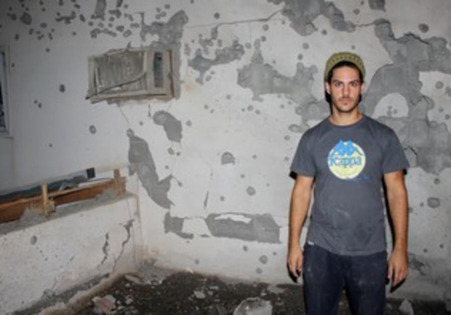 Ran Zohar outside his rocket-struck house