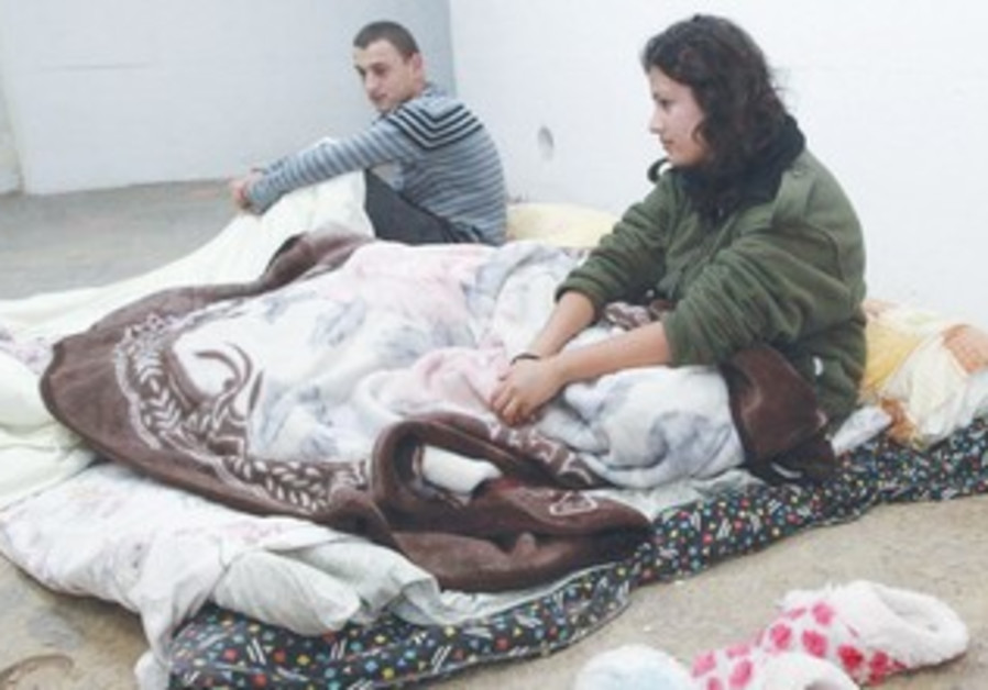 Couple beds down in Beersheba bomb shelter