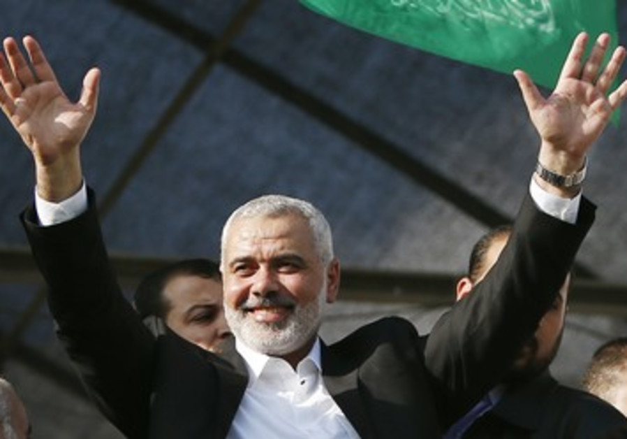 Hamas PM Haniyeh waves to people as they celebrate