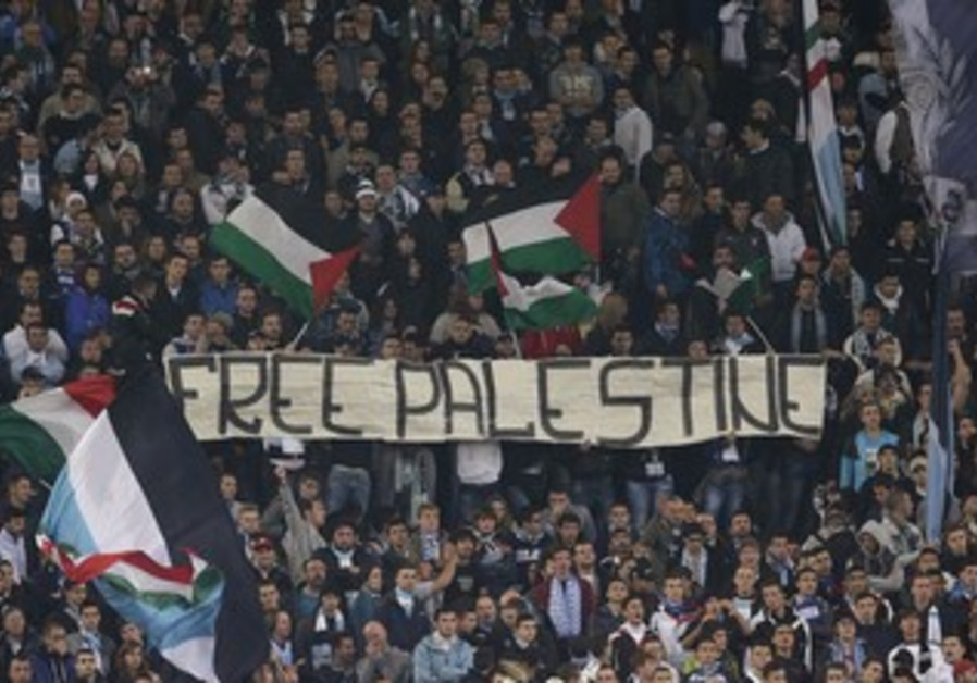 Lazio fans hold banner during Europa League match