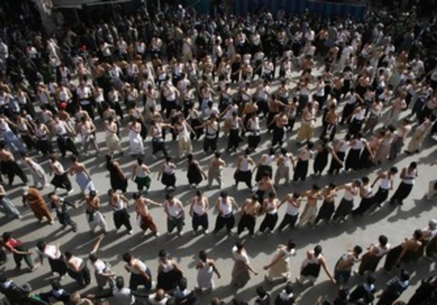 Shi'ite Muslim people take part procession