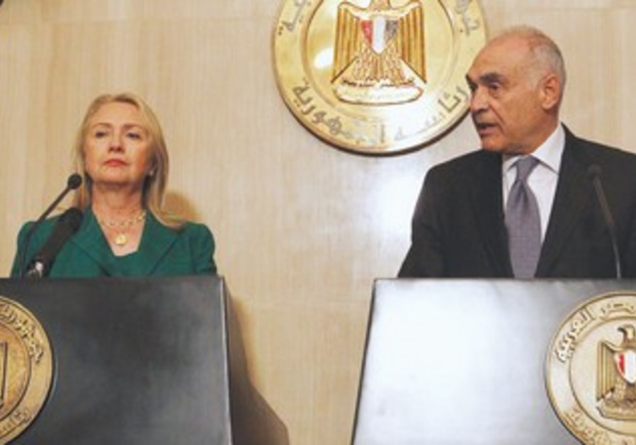 Hillary Clinton with Egyptian counterpart Amr