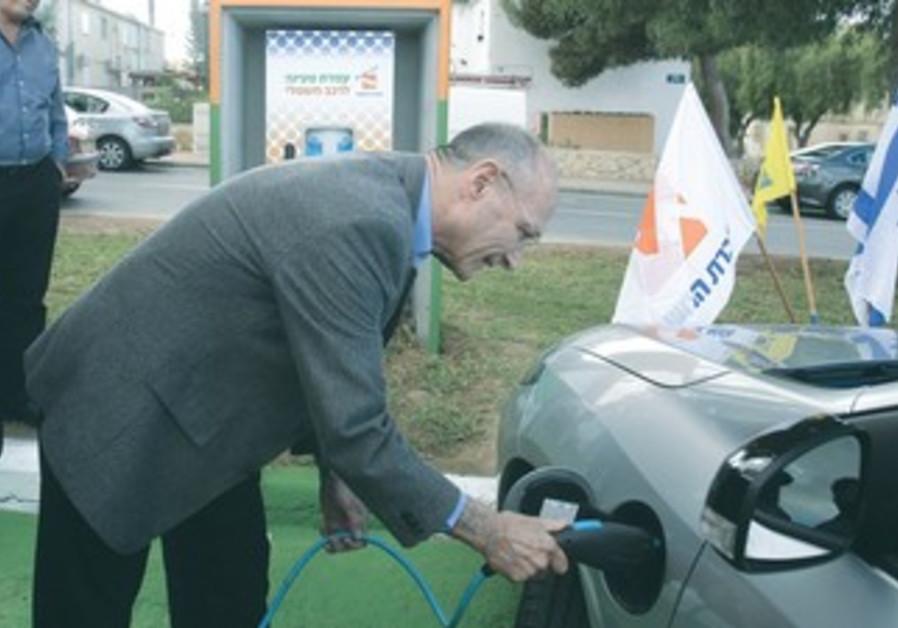 Landau charges up his car in Mitzpe Ramon