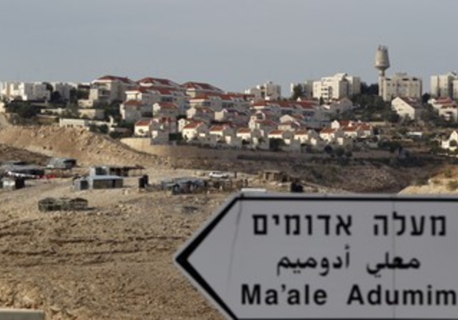 An Israeli settlement next to a Beduin camp in the West Bank.