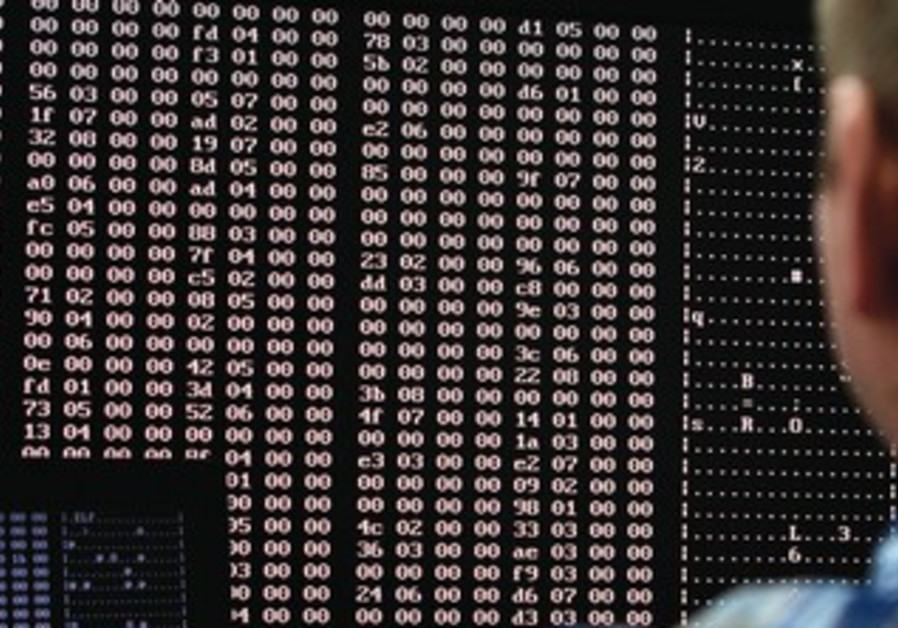 Man analyzes computer code
