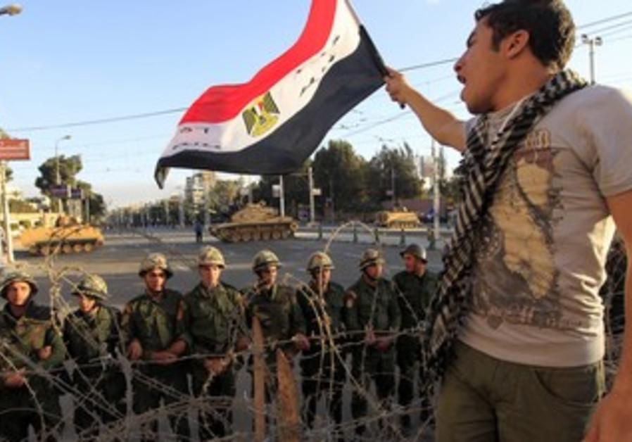A protester against Egypt's President Mohamed Mors