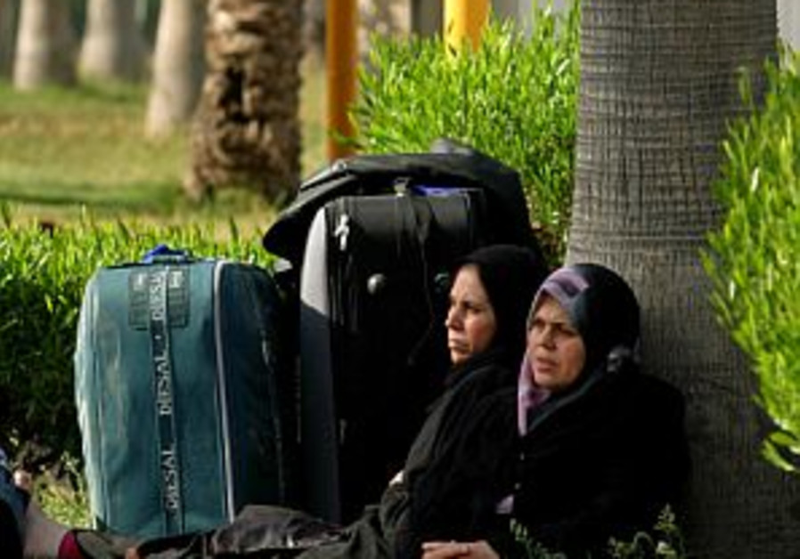 palestinian women wait outside rafah 298.88