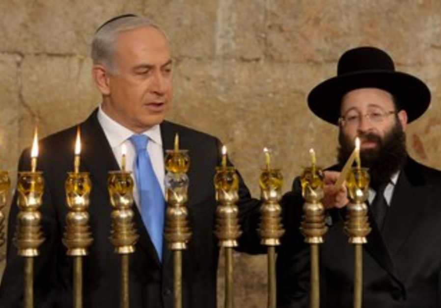 Prime Minister lights the Hanukkiyah