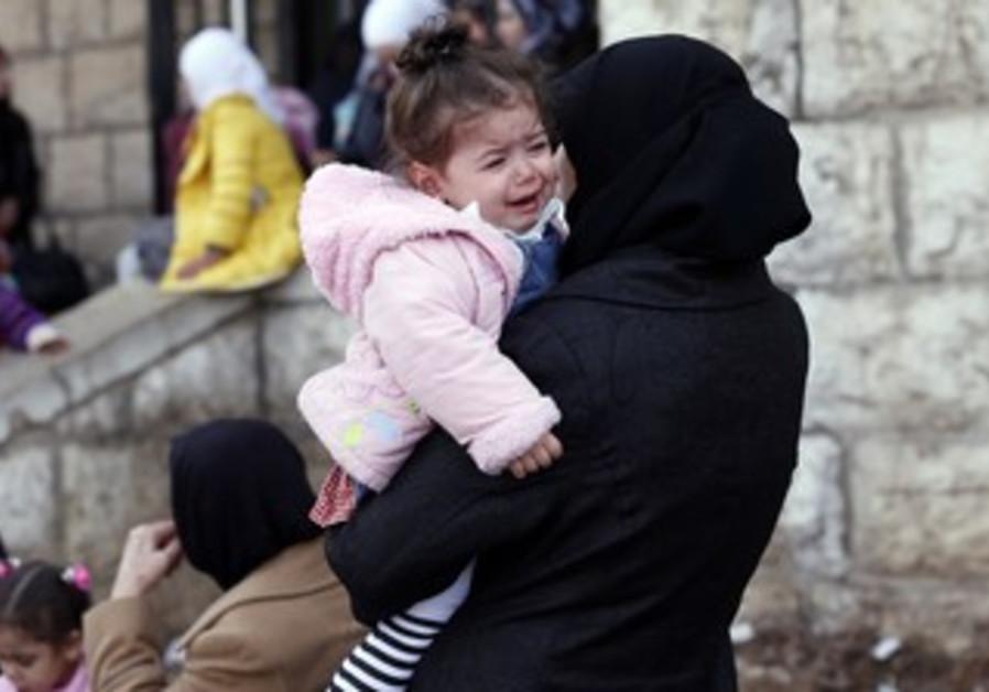Palestinians wait outside Lebanese immigration.