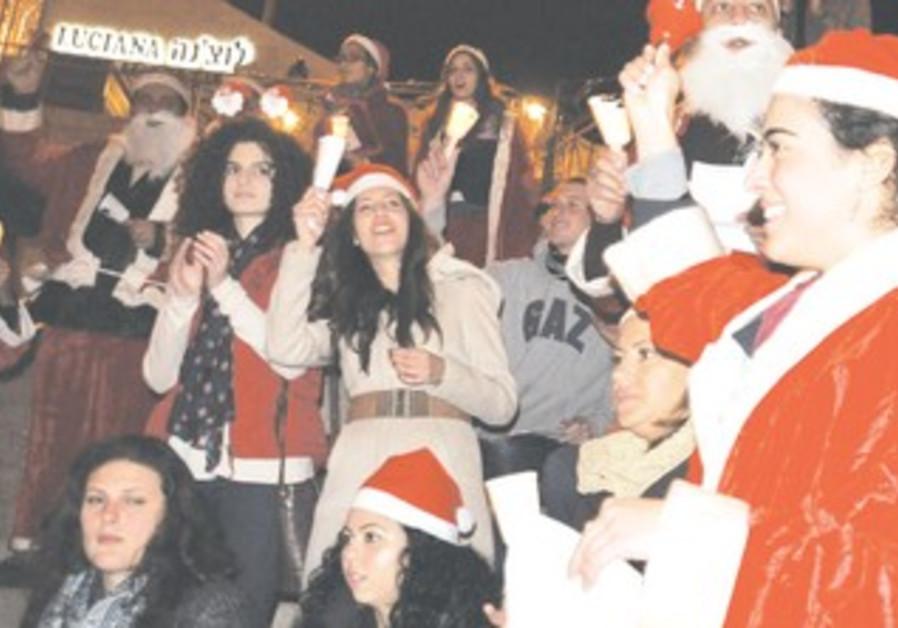 Celebrants dressed as Santa at J'lem's Mamilla