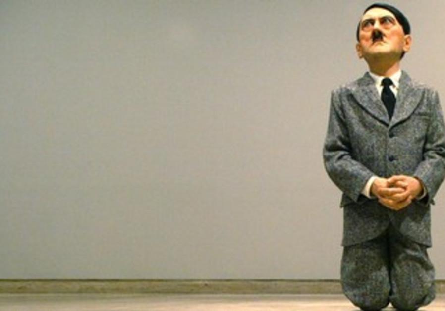 Kneeling Hitler statue