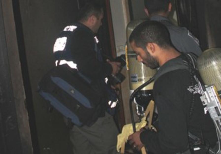 Firefighters at Herzliya spa fire site