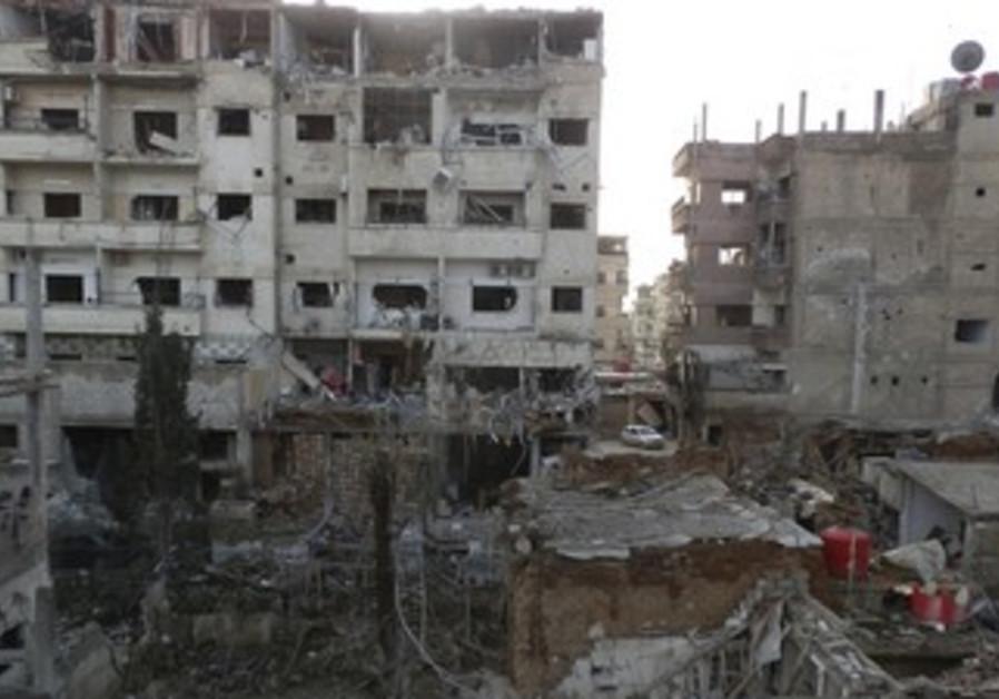 Damaged buildings in Daraya near Damascus