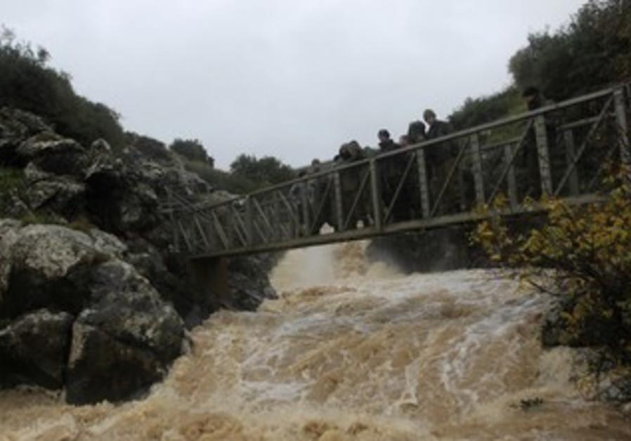 IDF soldiers on bridge over Saar falls in Golan