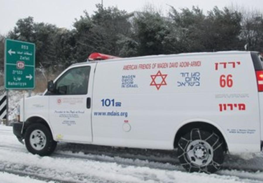 Ambulance in slush-covered streets of Safed