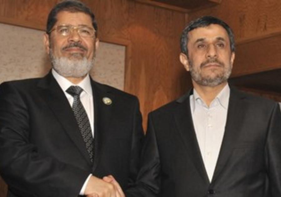 Morsi and Ahmadinejad in Tehran, August 30, 2012.