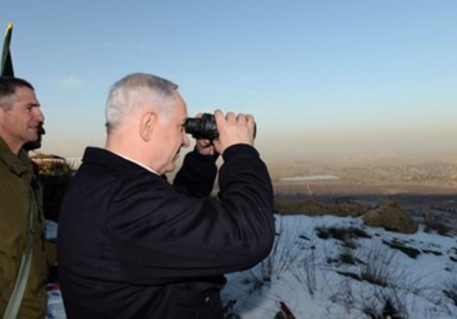 Netanyahu surveys Syrian border, Jan 13, 2011