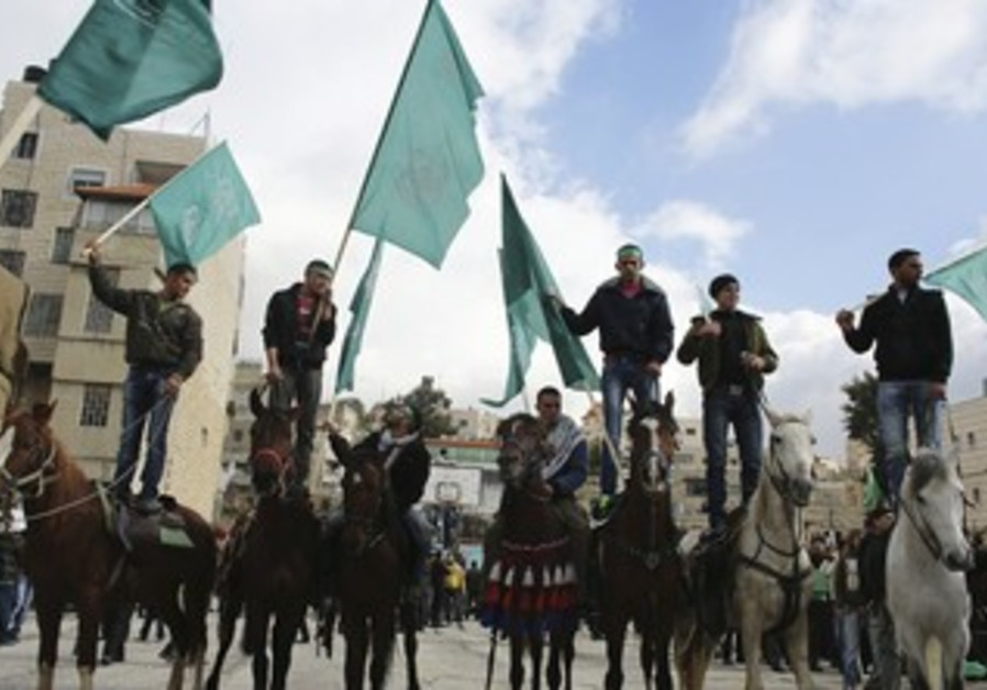 Hamas supporters rally in Hebron