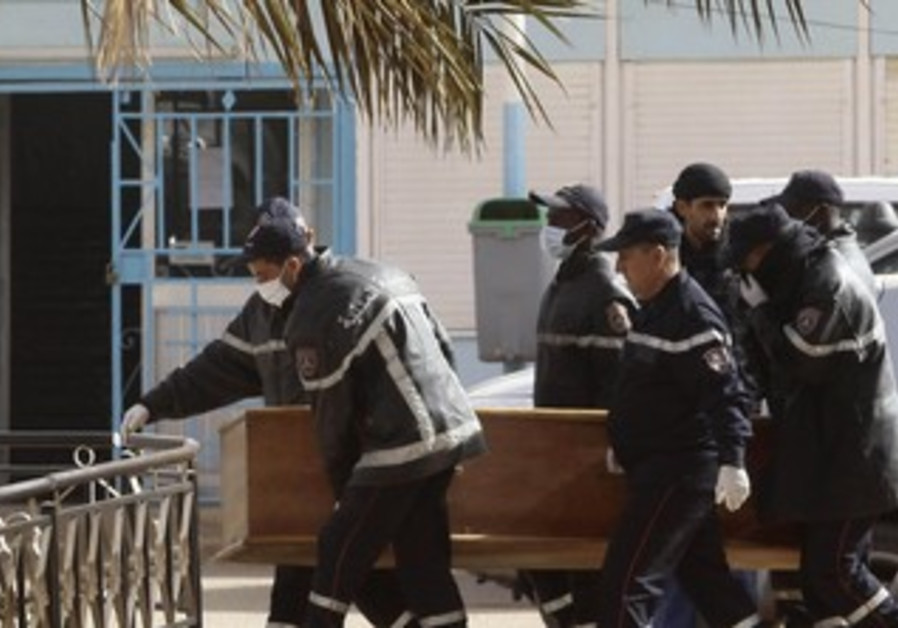 Algeria rescue workers carry coffin, January 21, 2013