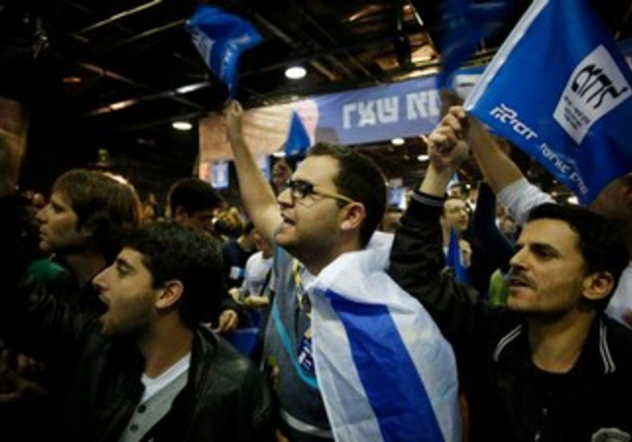 Likud supporters celebrate at HQ after polls close, January 22, 2013