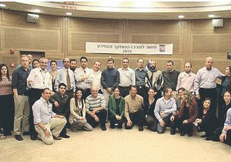 Dr. Gilad Natan (fourth left) posing with the Knesset Research and Information Center.