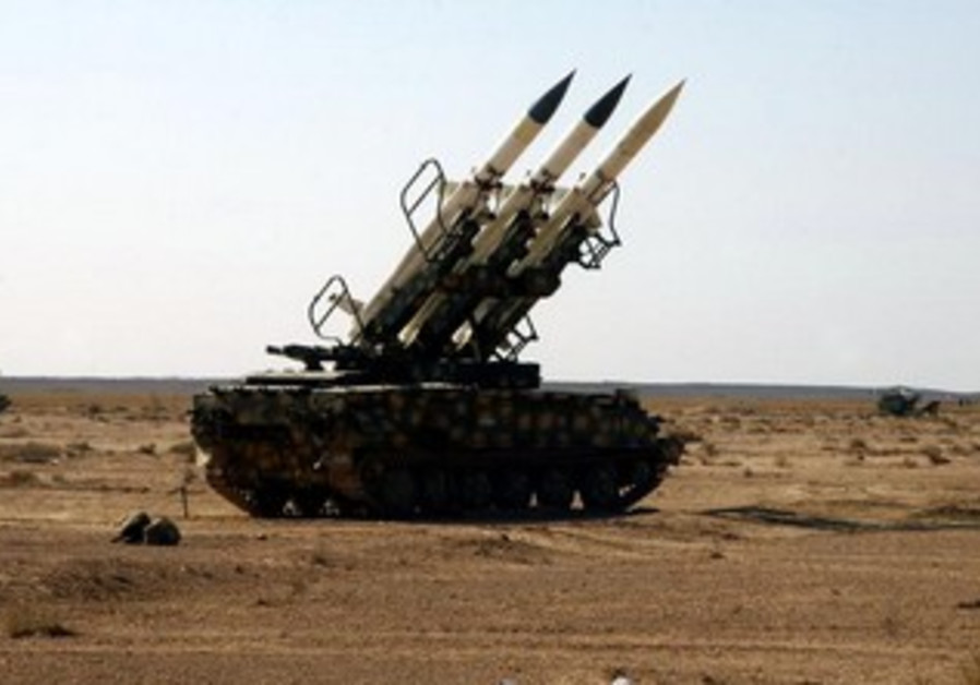 Syrian armed forces anti-aircraft missile launchers are deployed during a live ammunitions exercise