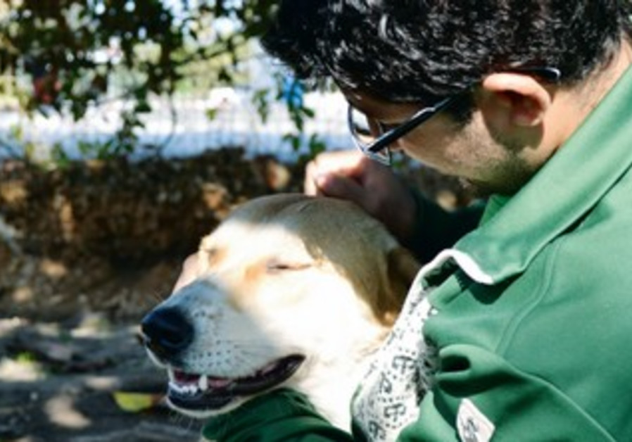 Tel Aviv animal shelter volunteer Nadav Abu with Yafit