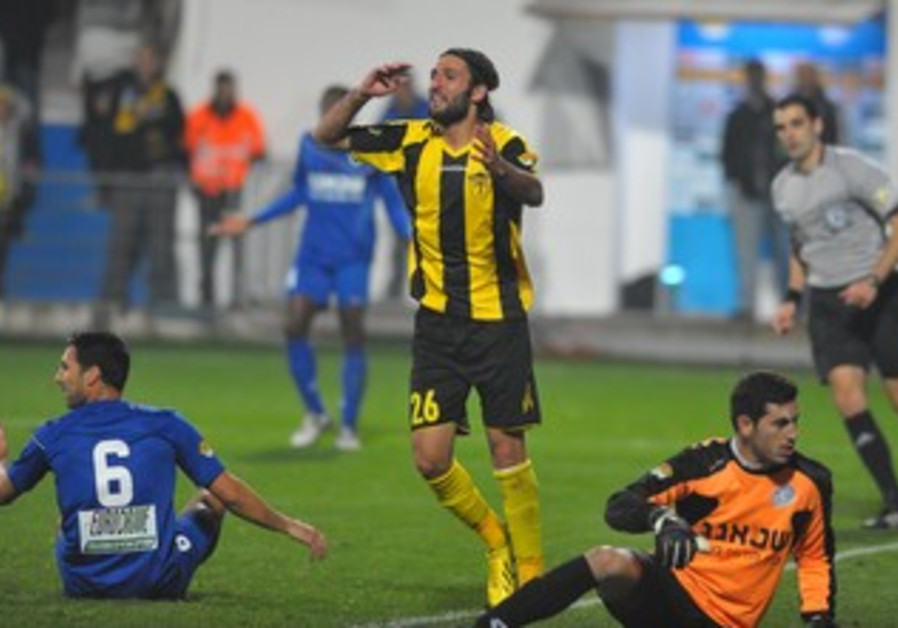 BETAR JERUSALEM midfielder Steven Cohen (standing) could do nothing to help avoid a 1-0 defeat