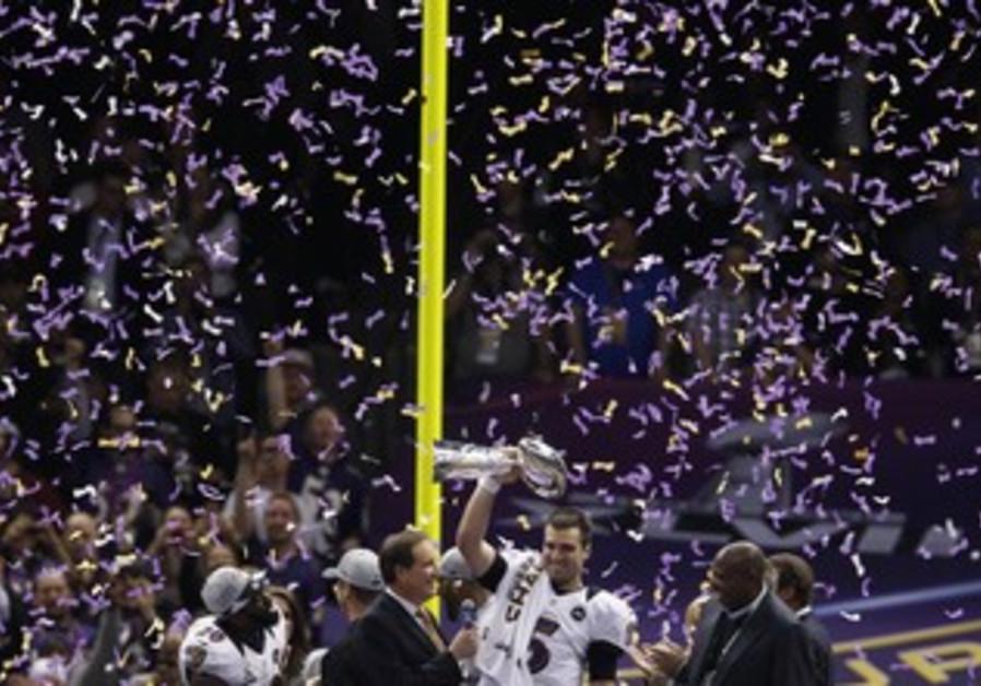 Baltimore Ravens QB Joe Flacco celebrates after Super Bowl win on February 3, 2013